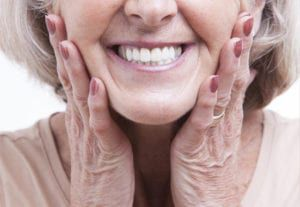 older woman holding her cheeks